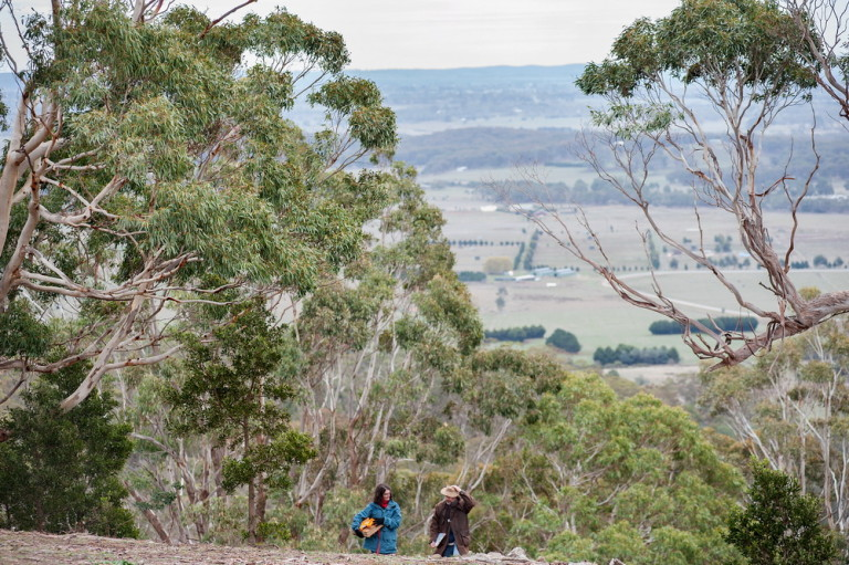 A Landcare volunteer and ecologist discuss Biolink plans on top of the Jim Jims ,near Newham.©Scheltema