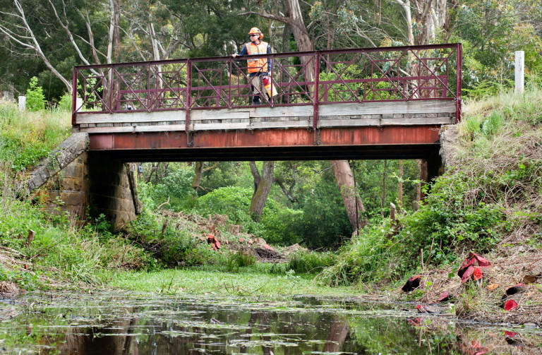 Trentham Landcare was delighted to recieve news that they were succesful in a Hepburn Shire Community Grant to continue their work in weed removal and native plantings at the Historic Enders Bridge. Pic Scheltema