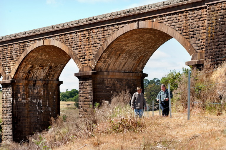 Along with other members of Malmsbury District Landcare Rob Burdett and John Walters, seen above, are working on a long term project -'Reclaim the Reserve', to remove weeds, plant native vegetation and continue creating a walking track near the Malmsbury Viaduct.                                                       Pic Scheltema