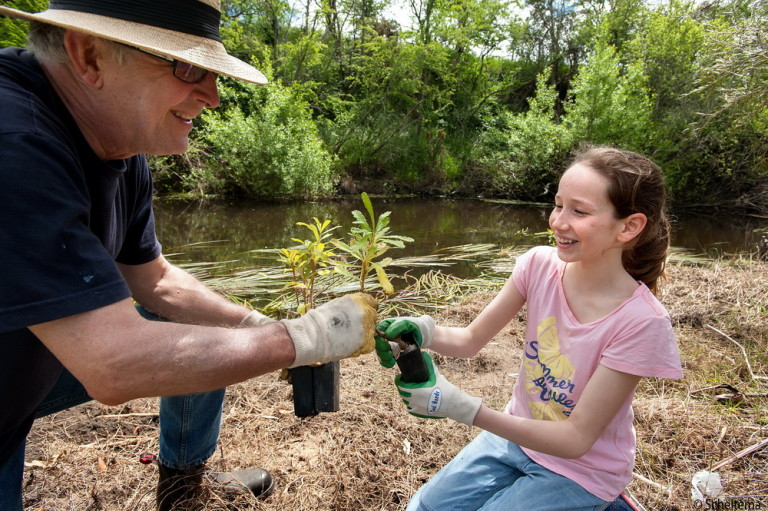 Kyneton Secondary College Student Penny Caleo helps President of Campasep River and Land management group at a planting day on the Campaspe. River.