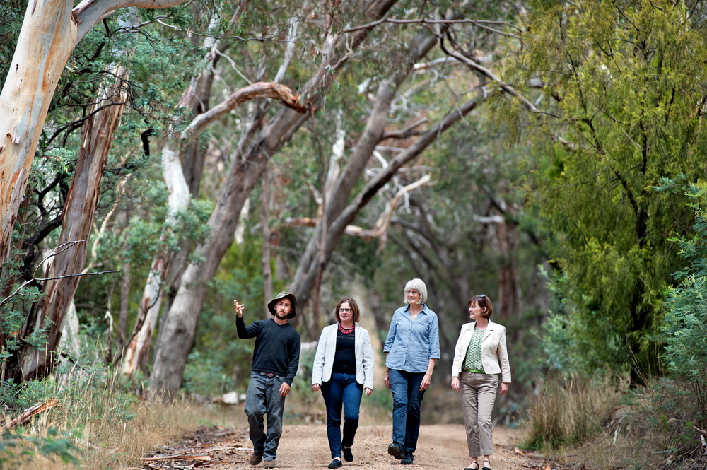 Ecologist Karl Just explains to Federal Member for Bendigo Lisa Chesters,Landcare Member Alice Aird,and State member for Macedon Mary-Anne Thomas how areas of remnant roadside vegetation in the Newham area contain endangered vegetation communities and threatened species,some of which are protected under Federal Legislation.Landcare groups are concerned that it is not receiving adequate protection.©Scheltema